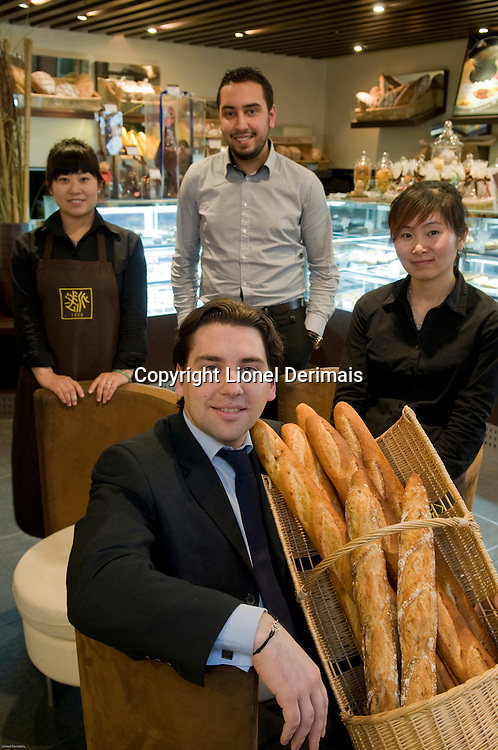 Benjamin Devos (sitting) CEO of Comptoir de France with his operational manager Hicham Baylal and sales assistants Jennifer (L) and Lisa (R) for Prisma Presse France magazine Capital.
