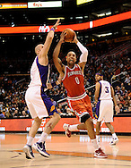 Jan. 8, 2012; Phoenix, AZ, USA; Milwaukee Bucks forward Drew Gooden (0) puts up a shot against the Phoenix Suns center Marcin Gortat (4) during the  half at the US Airways Center. The Suns defeated the Bucks 109-93. Mandatory Credit: Jennifer Stewart-US PRESSWIRE.