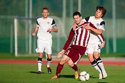 Davor Bubanja #33 of Triglav vs Damjan Bohar #9 of Mura during football match between NK Triglav and NK Mura 05 in 17th Round of PrvaLiga NZS 2012/13 on November 7, 2012 in Kranj, Slovenia. (Photo By Vid Ponikvar / Sportida)