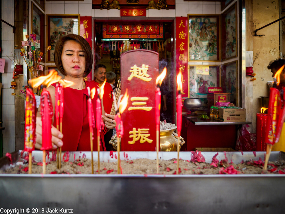 15 FEBRUARY 2018 - BANGKOK, THAILAND: People pray for Tet at the Heng Chia Shrine (dedicated to the Chinese Monkey God) in Bangkok's Chinatown. Lunar New Year, also called Tet or Chinese New Year, is 16 February this year. The coming year will be the Year of the Dog. Thailand has a large Chinese community and Lunar New Year is widely celebrated in Thailand, especially in Bangkok and large cities with significant Chinese communities.     PHOTO BY JACK KURTZ