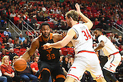 LUBBOCK, TX - MARCH 1: Shaquille Cleare #32 of the Texas Longhorns handles the ball against Matthew Temple #34 of the Texas Tech Red Raiders during the game on March 1, 2017 at United Supermarkets Arena in Lubbock, Texas. Texas Tech defeated Texas 67-57. (Photo by John Weast/Getty Images) *** Local Caption *** Shaquille Cleare;Matthew Temple