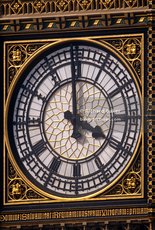 A detail of the clock face to the Elizabeth Tower in London. It's close to 4pm and we see the hands and neo-Gothic design. The Elizabeth Tower (previously called the Clock Tower) named in tribute to Queen Elizabeth II in her Diamond Jubilee year - was raised as a part of Charles Barry's design for a new palace, after the old Palace of Westminster was largely destroyed by fire on the night of 16 October 1834. The new Parliament was built in a Neo-gothic style. Although Barry was the chief architect of the Palace, he turned to Augustus Pugin for the design of the clock tower. It celebrated its 150th anniversary on 31 May 2009. The tower was completed in 1858 and has become one of the most prominent symbols of both London and England,