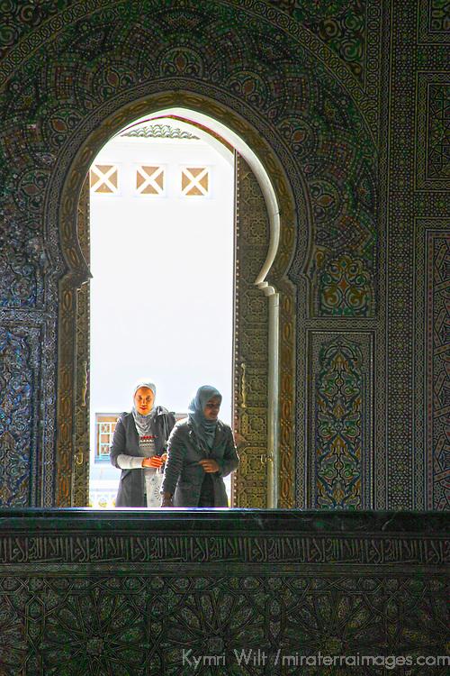 Africa, Morocco, Rabat. Women entering Mausoleum of Mohammed V.