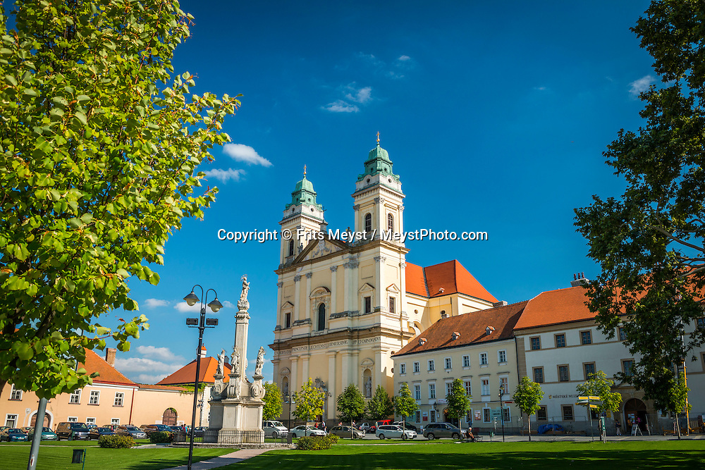 Valtice, Moravia, Czech Republic, September 2015. Valtice's 12th-century castle is one of the country's finest baroque structures, the work of JB Fischer von Erlach and Italian architect Domenico Martinelli. Valtice's most significant church is this early baroque work, dating from the middle of the 17th century. Take a look inside to admire the rare baroque organ from the 18th century. Behind the main altar are two significant paintings: the larger is a copy of a Rubens, but the smaller one above it, depicting the Holy Trinity, is a Rubens original. Southern Moravia is most famous for its wine,  rolling hills and pretty landscapes. Photo by Frits Meyst / MeystPhoto.com