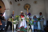 "Mexico, Oaxaca, Teotitlan del Valle, April 21-22, 2011. True faith suffuses every aspect of Teotitlan del Valle's painstaking recreation of the last hours of Jesus, from Thursday's afternoon's Last Supper through to a night vigil at a jail cell after his arrest. Village elders play the parts of the twelve apostles, and the town's devout fill the church for mass and communion, for the ritual washing of the disciple's feet, and for multiple gatherings which mark the hours. Good Friday dawns with music, scripture, and a solemn procession of Christ, the Virgin Mary and the town's own radiant""Virgen Dolorosa"" through the streets."