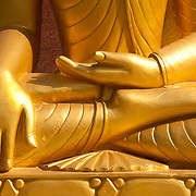 India. Bihar. Bodhgaya, the town where the Buddha sat under a sacred fig tree (bhodi tree) and received enlightenment. Detail of Buddha hands in hand touching ground pose, the moment when the Buddha received enlightenment