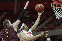 11 January 2014: Zach Lofton  gets past Cody Johnson for a lay up during an NCAA  mens basketball game between the Ramblers of Loyola University and the Illinois State Redbirds  in Redbird Arena, Normal IL.  Redbirds win 59-50