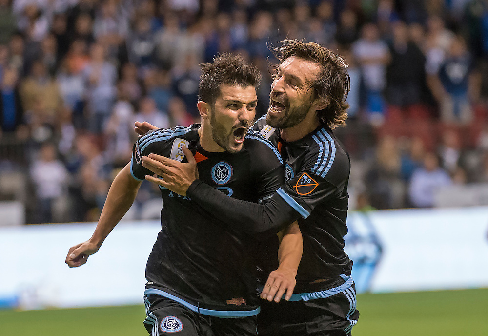 MLS Soccer- New York City captain, David Villa (left) and Andrea Pirlo celebrate Villa's winning goal on a penalty kick in extra time in MLS action at BC Place Stadium in Vancouver.