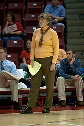 20 November 2004<br /> <br /> ISU Head Coach Sharon Dingman keeps a watchful eye on the action.<br /> <br /> Illinois State University Redbirds V Drake Bulldogs Women's Volleyball.  Redbird Arena, Illinois State University, Normal IL