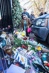 Highgate, London, December 26th 2016. Fans gather outside the London home of pop icon George Michael who died on Christmas day. PICTURED: A tearful woman places flowers at the gate.