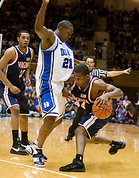 Virginia guard Sean Singletary (44) is guarded by Duke guard DeMarcus Nelson (21).  The Duke Blue Devils hosted the Virginia Cavaliers in men's basketball at Cameron Indoor Stadium on the campus of Duke University in Durham, NC on January 13, 2008.
