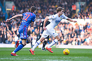Patrick Bamford of Leeds United (9) gets past Joe Williams of Bolton Wanderers (21) during the EFL Sky Bet Championship match between Leeds United and Bolton Wanderers at Elland Road, Leeds, England on 23 February 2019.