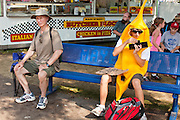 "01 SEPTEMBER 2011 - ST. PAUL, MN:  A high school student in a banana suit at the Minnesota State Fair. The teenager said he wore the suit to the fair to see how people would react to him. The Minnesota State Fair is one of the largest state fairs in the United States. It's called ""the Great Minnesota Get Together"" and includes numerous agricultural exhibits, a vast midway with rides and games, horse shows and rodeos. Nearly two million people a year visit the fair, which is located in St. Paul.   PHOTO BY JACK KURTZ"