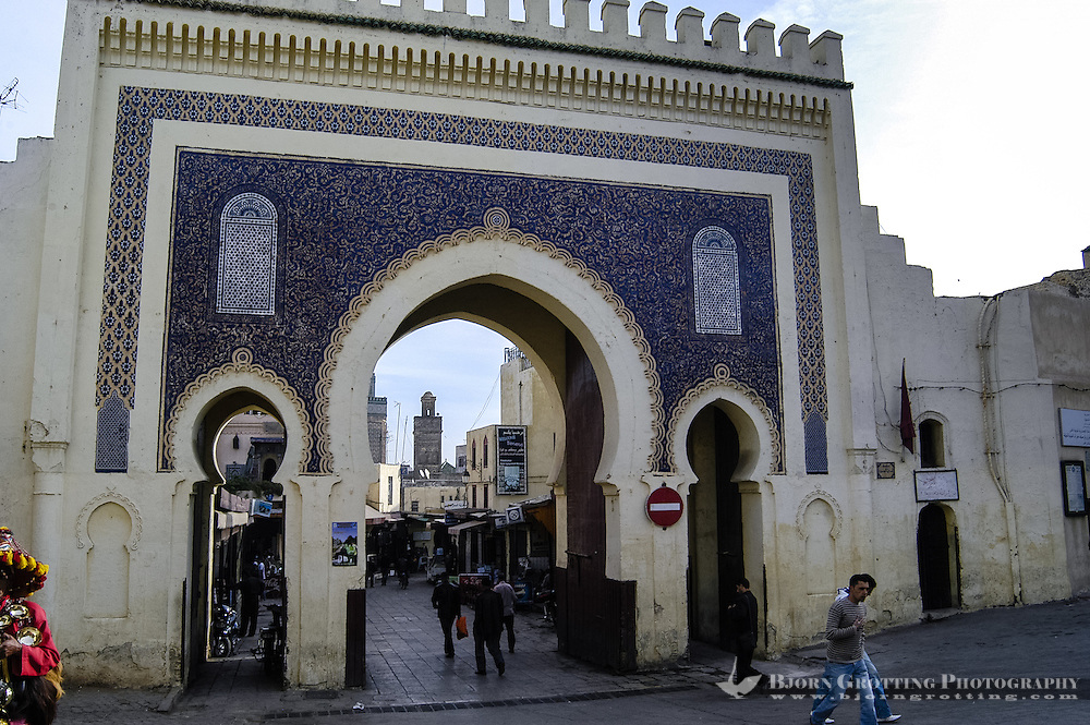 Morocco. The medina in Fes, Fes el Bali, is on UNESCO's World Heritage Site list. The blue gate, which is green on the other side.