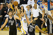 Golden State Warriors guard Stephen Curry (30) shoots a floater against the San Antonio Spurs at Oracle Arena in Oakland, Calif., on October 25, 2016. (Stan Olszewski/Special to S.F. Examiner)