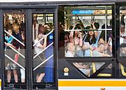 China, Sichuan. Chengdu. Public bus during morning rush hour.