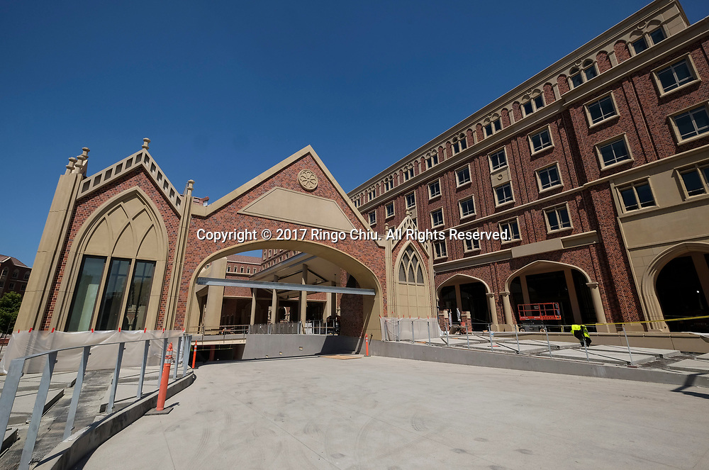 The parking garage entrance and the future Trader Joe's and Target locations in USC's University Village. USC's $700 million shopping and residential complex is nearly complete and more than a dozen retailers (Trader Joe's, Target, Starbucks, etc.) are set to open in August. (Photo by Ringo Chiu)<br /> <br /> Usage Notes: This content is intended for editorial use only. For other uses, additional clearances may be required.
