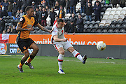 Milton Keynes Dons midfielder Antony Kay(6) clears the  ball away from Hull City striker Abel Hernandez (9) during the Sky Bet Championship match between Hull City and Milton Keynes Dons at the KC Stadium, Kingston upon Hull, England on 12 March 2016. Photo by Ian Lyall.