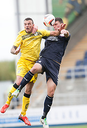 Queen of the South's Derek Lyle and Falkirk's Jonathan Flynn.<br /> half time : Falkirk 1 v 0 Queen of the South, Scottish Championship 5/10/2013.<br /> &copy;Michael Schofield.
