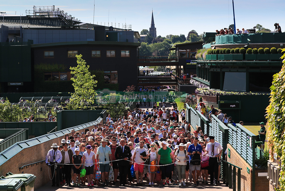 7 July 2017 - Wimbledon Tennis (Day 5) - Stewards lead the early crowd to Henmans Hill - Photo: Charlotte Wilson