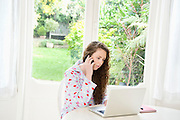 Woman on call while working on laptop