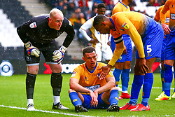 Conrad Logan and Krystian Pearce check on an injured Matt Preston of Mansfield Town - Mandatory by-line: Ryan Crockett/JMP - 04/05/2019 - FOOTBALL - Stadium MK - Milton Keynes, England - Milton Keynes Dons v Mansfield Town - Sky Bet League One