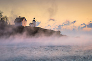 Sea Smoke billows around Curtis Island Lighthouse on a frigid morning in December.
