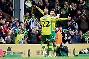 Norwich City forward Teemu Pukki (22) celebrates his goal with Norwich City midfielder Emi Buendía (17) during the EFL Sky Bet Championship match between Norwich City and Queens Park Rangers at Carrow Road, Norwich, England on 6 April 2019.