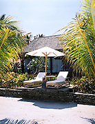 Beach villa lounge chairs.
