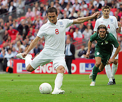 Frank Lampard scores England's 1st goal from the spot during the international friendly match between England and Slovenia at Wembley Stadium, London on the 5th September 2009