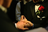 Joe Alfano, 37, places a wedding ring on the hand of his domestic partner, Frank Capley, 33, during their wedding ceremony, at City Hall, in San Francisco, CA, on Tuesday, June 17, 2008. The couple have been together for 8 years. They first married in 2004.