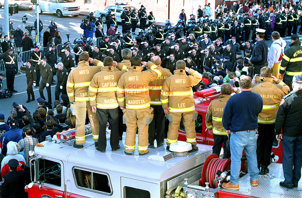Parade passes by the home Fire Station of 2 of the dead Worcester Firefighters as covering Mutual Aide Firefighters (from No. Reading and Marblehead) salute back from on top of Marblehead Fire Engine..Staff Photo: Mark Garfinkel