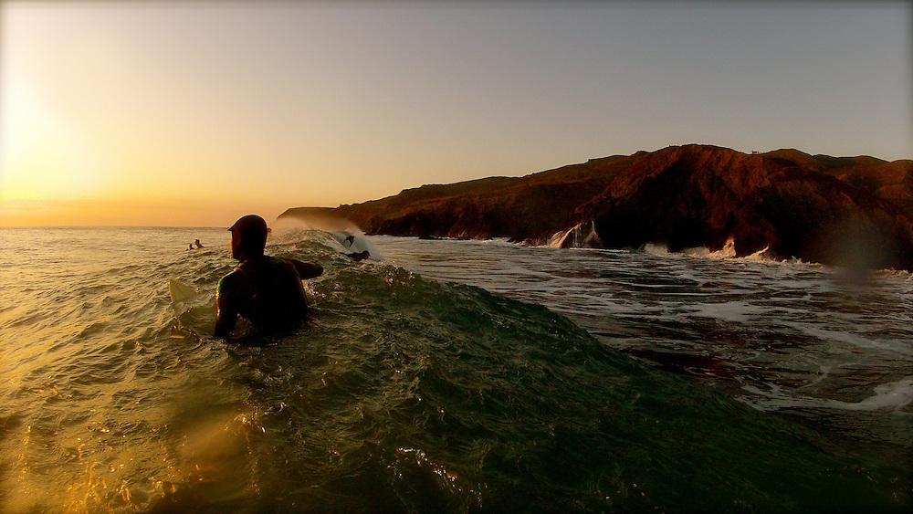 Surfer at Cronkite Beach north of San Francisco, CA.
