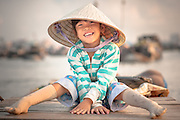 Vietnamese girl on boat on Mekong River