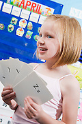 Elementary Student with Alphabet Flash Cards