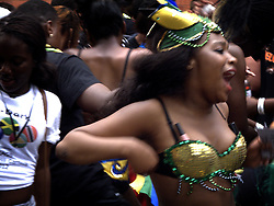 UK ENGLAND LONDON 27AUG12 - Revellers dance at the Notting Hill Carnival in west London.....The Notting Hill Carnival is the largest street festival in Europe and originated in 1964 as a way for Afro-Caribbean communities to celebrate their own cultures and traditions...jre/Photo by Jiri Rezac....© Jiri Rezac 2012