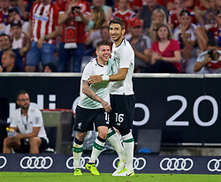 MUNICH, GERMANY - Tuesday, August 1, 2017: Liverpool's Marko Grujic celebrates scoring a goal with team-mate Alberto Moreno, only for it to be disallowed, during the Audi Cup 2017 match between FC Bayern Munich and Liverpool FC at the Allianz Arena. (Pic by David Rawcliffe/Propaganda)