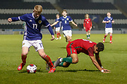 Stuart Mckinstry (Motherwell) wins the ball from Rafael Brito during the U17 European Championships match between Portugal and Scotland at Simple Digital Arena, Paisley, Scotland on 20 March 2019.