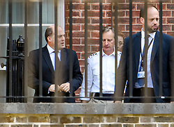 © Licensed to London News Pictures. 19/09/2019. London, UK. Defence secretary BEN WALLACE (left) is seen leaving Downing Street via a back exit. The Supreme Court is currently hearing evidence from former Prime Minster John Major at day three of an appeal against a ruling on the proroguing of parliament. Photo credit: Ben Cawthra/LNP