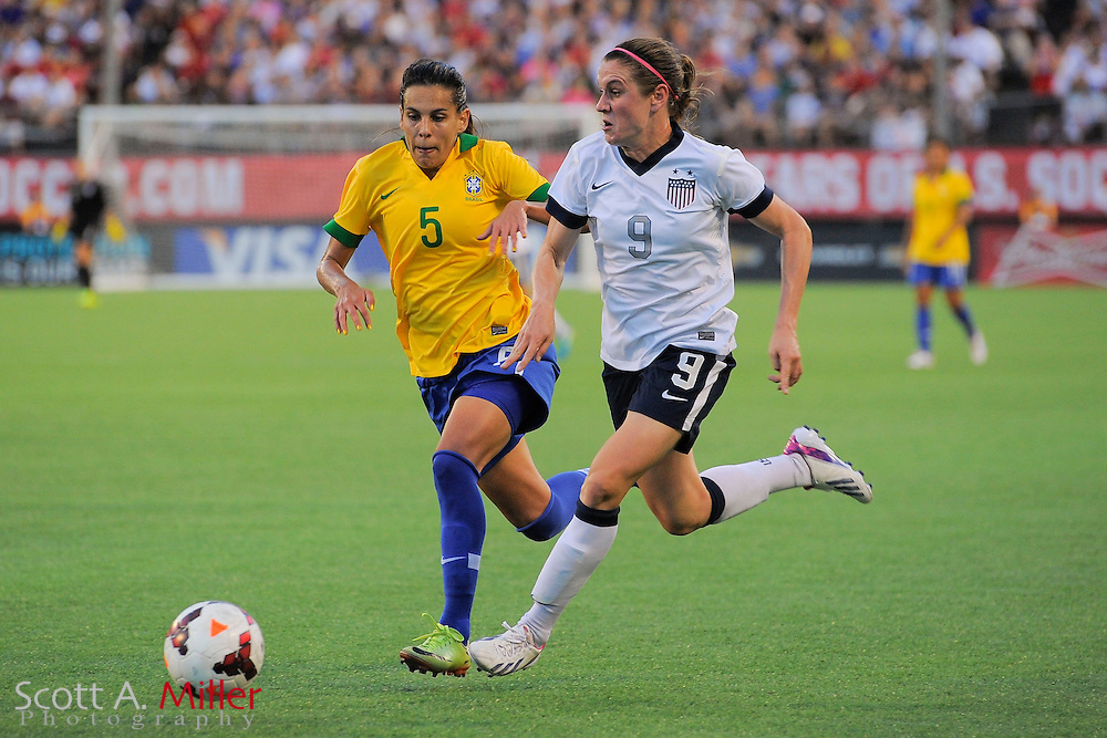 U.S. midfielder Heather O'Reilly (9) and Brazil midfielder Thaisa (5) fight for a ball during an international friendly at the Florida Citrus Bowl on Nov. 10, 2013 in Orlando, Florida.  The U.S. won 4-1.<br /> <br /> <br /> &copy;2013 Scott A. Miller