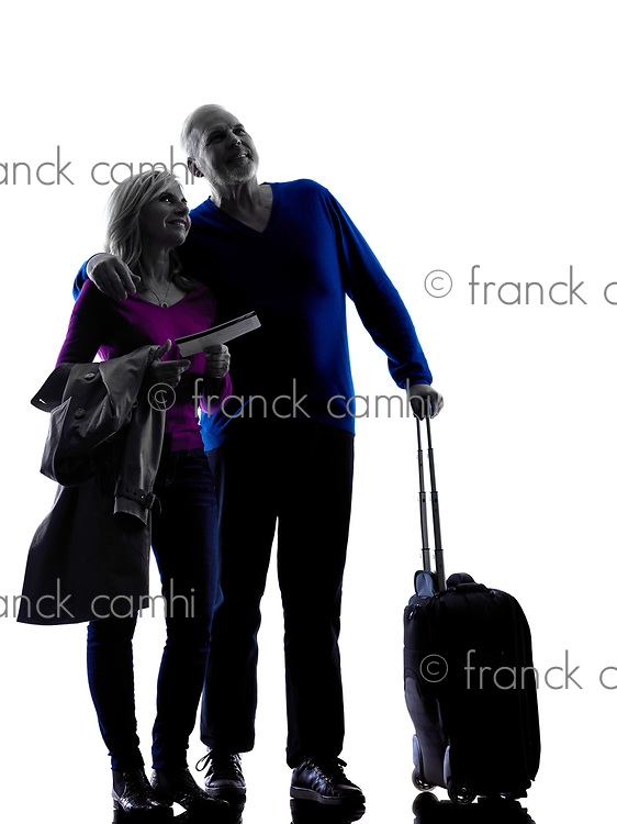 one caucasian couple senior travelers traveling  silhouette  in silhouette studio isolated on white background