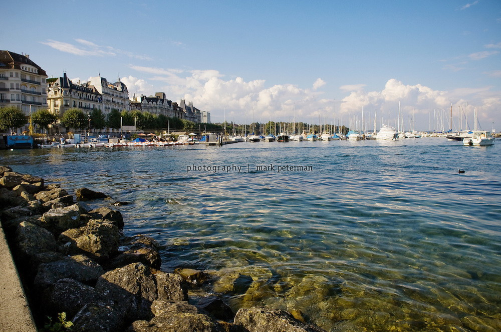 The harbor of Geneva, Switzerland where boats line the shore of Lake Geneva (Lac Leman).