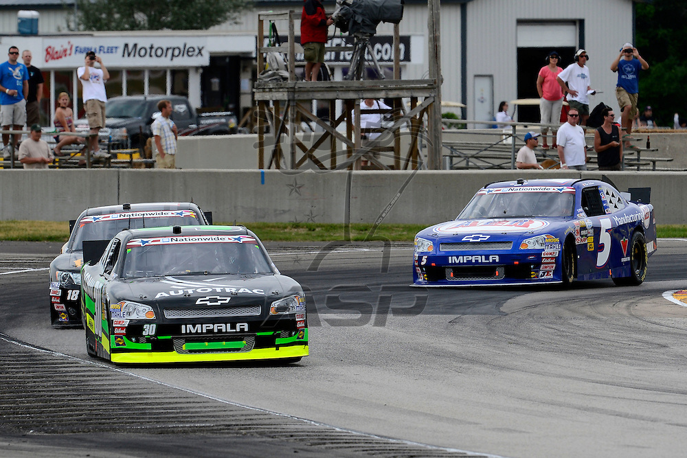 Elkhart Lake,WI - JUN 23, 2012: Nelson Piquet Jr. (30) races with Michael McDowell (18) during race action for the  Sargento 200  race at the Road of America in Elkhart Lake , WI.
