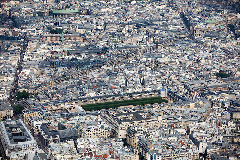 The Palais-Royal originally called the Palais-Cardinal, is a palace located in the 1st arrondissement of Paris. The screened entrance court faces the Place du Palais-Royal, opposite the Louvre. The larger inner courtyard, the Cour d'Honneur, has since 1986 contained Daniel Buren's site-specific art piece Les Deux Plateaux, known as Les Colonnes de Buren.
