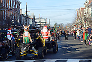 Inflated Santa Claus and reindeer rest on the back of some 4 wheel drive vehicles during the Newtown Holiday Parade Sunday December 6, 2015 in Newtown, Pennsylvania. (Photo by William Thomas Cain)