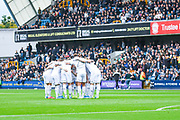Leeds United players huddle during the EFL Sky Bet Championship match between Millwall and Leeds United at The Den, London, England on 5 October 2019.