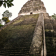 Temple 5 at Tikal Maya Ruins in northern Guatemala. At about 187 feet high, it is the second tallest of the buildings at Tikal and is a mortuary pyramid. It is believed to have been built around 700 AD. The section at the top was once covered with detailed artistic carvings and the whole structure was painted.