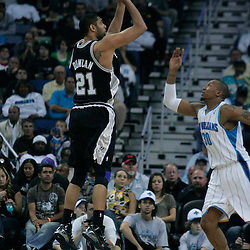 29 March 2009: San Antonio Spurs center Tim Duncan (21) shoots over New Orleans Hornets forward David West (30) during a 90-86 victory by the New Orleans Hornets over Southwestern Division rivals the San Antonio Spurs at the New Orleans Arena in New Orleans, Louisiana.
