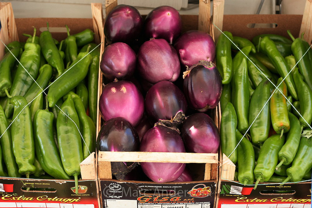 Fresh green capsicums and aubergines in a food market, Calabria, Italy