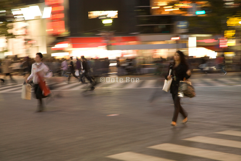 last people running across the zebra crossing in Shibuya before traffic light gets red